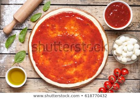 pizza base with tomato sauce Stock photo © M-studio
