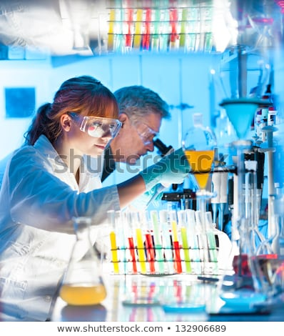 Attractive young scientist pipetting. Stock photo © kasto