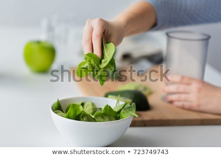 Baby eating spinach Stock photo © Lighthunter