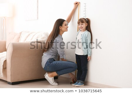 Young woman with measuring scale stock photo © Kzenon