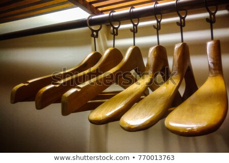 set of wooden coat hangers for wardrobe clothes stock photo © loopall