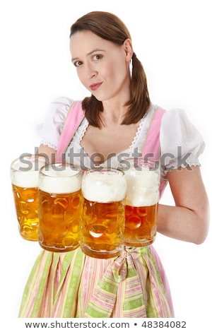 Oktoberfest, young waitress in dirndl with many beer mugs  Stock photo © runzelkorn