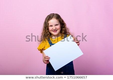 baby in pink on white sheet Stock photo © Mikko