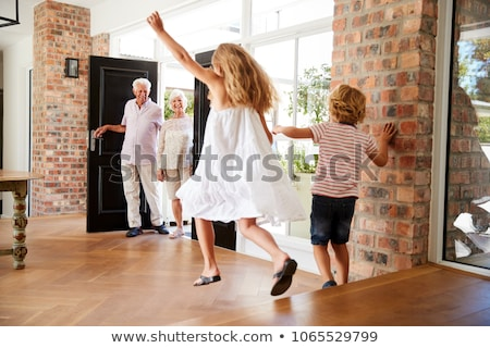 Senior man with grandson jumping in air Stock photo © monkey_business