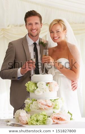 Zdjęcia stock: Oblubienicy · pan · młody · ciasto · pitnej · szampana · recepcji