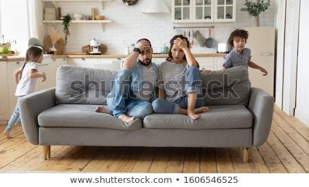 Gyereknevelés anya tart fej sekély mélységélesség Stock fotó © naumoid