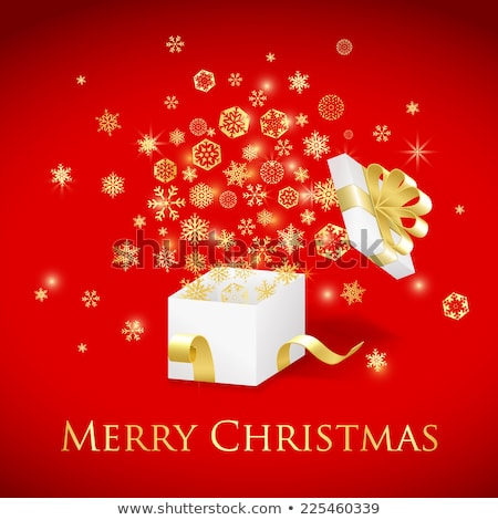 Christmas geschenkdoos goud lint vliegen sneeuwvlokken Stockfoto © liliwhite