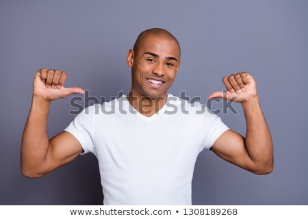 Young handsome african-american man in black cloths pointing at you isolated on white background Stock photo © deandrobot