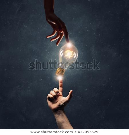 Creative ampoule connecter main doigt résumé Photo stock © vgarts