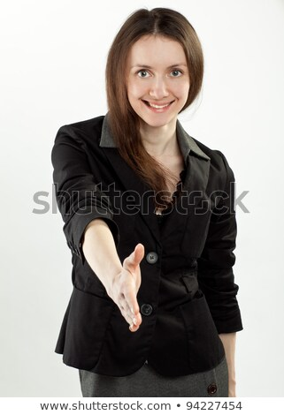 Glimlachend zakenvrouw handdruk toonzaal vrouw Stockfoto © wavebreak_media
