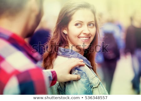Happy woman flirting with man outdoors Stock photo © deandrobot
