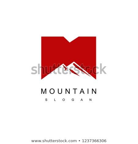 letter m mountain and sun symbol stock photo © blaskorizov