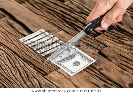 Knife cut paper with wages Stock photo © fuzzbones0