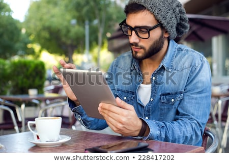Modern young man with digital tablet in the street. Stock photo © nenetus