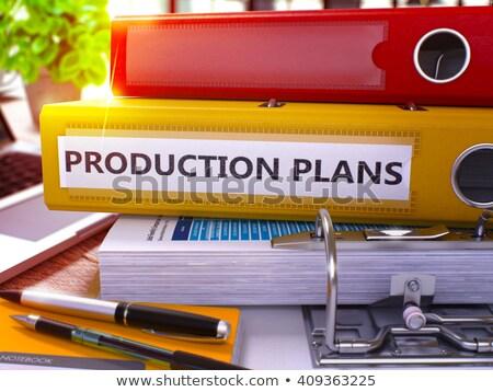 Red Ring Binder with Inscription Production Plans. Stock photo © tashatuvango