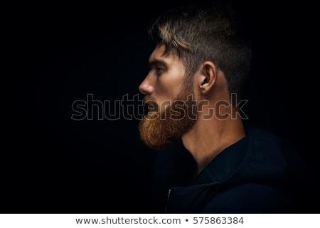 kacsintás · piros · szakállas · férfi · stúdió · portré - stock fotó © bezikus