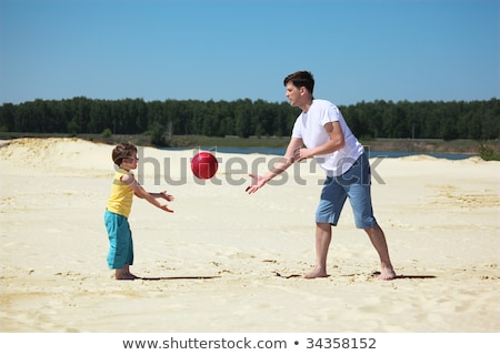father and son throw each other ball on sand Stock photo © Paha_L