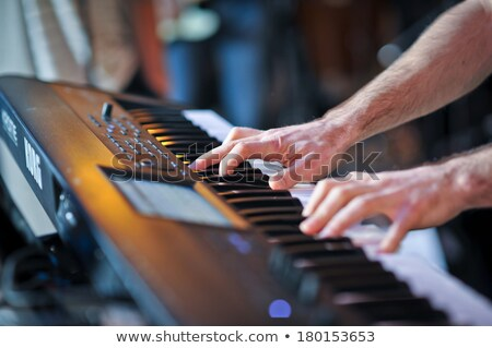 Keyboard player playing in studio. hands of keyboard player stock photo © Paha_L