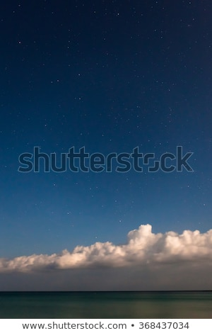 Starry sky with sea and clouds at bottom of image Stock photo © Juhku