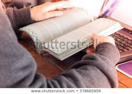 Woman reading book on work station Stock photo © punsayaporn