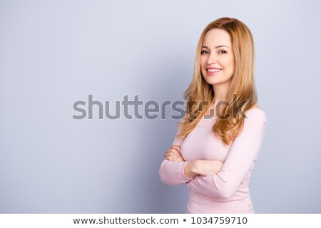 Portrait of cheerful attractive business woman with long wavy hair  Stock photo © deandrobot