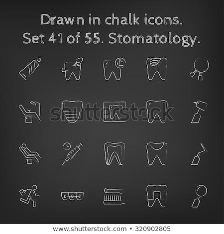 Dental pliers. Drawn in chalk icon. Stock photo © RAStudio