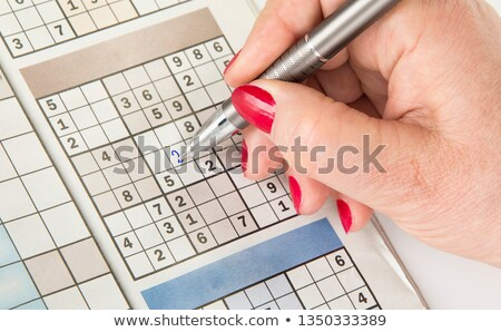 Top view of male hands solving sudoku puzzle Stock photo © stevanovicigor