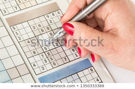 top view of male hands solving sudoku puzzle stock photo © stevanovicigor