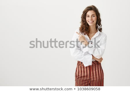 Calm young woman in white blouse with grin Stock photo © dash