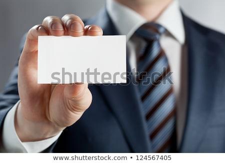 üzletember · mutat · piros · kártya · izolált · fehér - stock fotó © simply