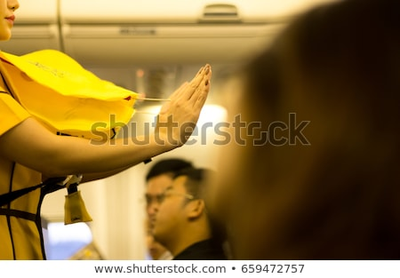 hostess with life jacket on airplane Stock photo © adrenalina