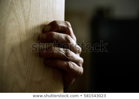 man hand popping out from behind a door Stock photo © nito
