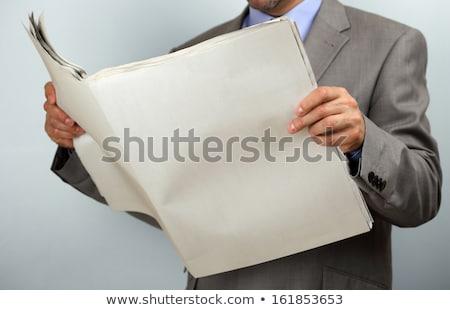 Man reading newspaper with the headline Stock Market Stock photo © Zerbor