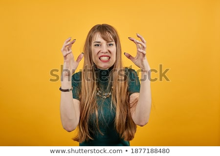 Head shot of woman scowling stock photo © monkey_business