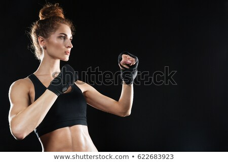 Side view of Calm female fighter ready to fight Stock photo © deandrobot
