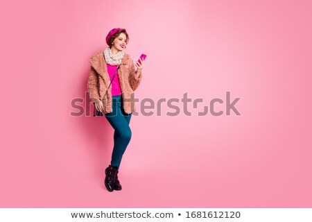 fashion girl look in pink fur coat holding mobile phone isolated stock photo © victoria_andreas