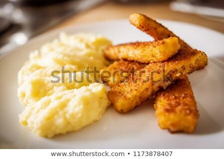 Fried fish sticks with mashed potato Stock photo © Digifoodstock