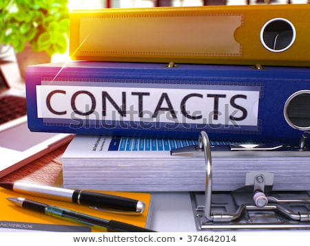 Contacts on Blue Ring Binder. Blurred, Toned Image. Stock photo © tashatuvango