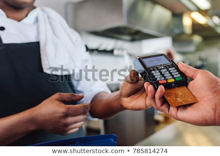 Customer making payment through credit card at counter Stock photo © wavebreak_media