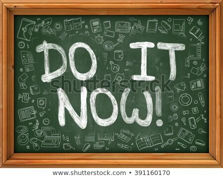 Do It Now Concept. Green Chalkboard with Doodle Icons. Stock photo © tashatuvango