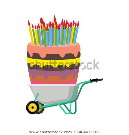 Wheelbarrow and big birthday cake. large Pie in garden trolley.  Stock photo © popaukropa