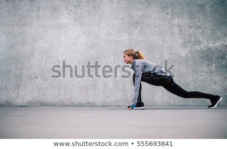 Woman runner doing stretching exercises Stock photo © IS2