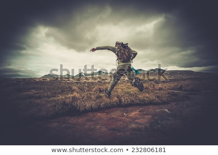 Man jumping across brook Stock photo © IS2