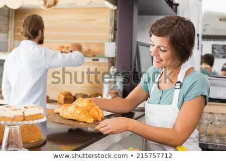 Waitress holding tray with coffee and croissant. Stock photo © RAStudio
