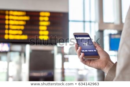Uçuşlar çevrimiçi cep telefonu uygulaması adam Stok fotoğraf © stevanovicigor