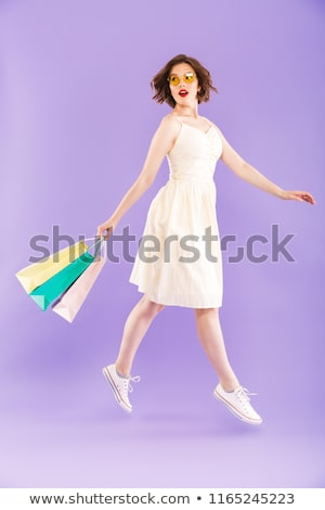 Shopping girl in violet with bag Stock photo © Massonforstock