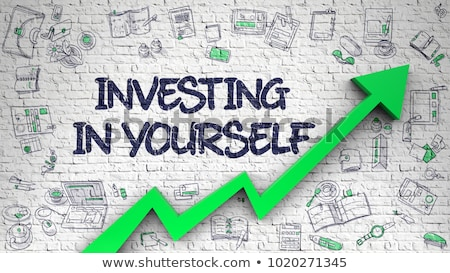 investing in yourself drawn on white brick wall stock photo © tashatuvango
