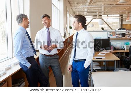 Drie zakenlieden vergadering kantoor zakenman pak Stockfoto © IS2
