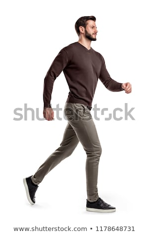 side view of a happy relaxed casual man walking stock photo © feedough