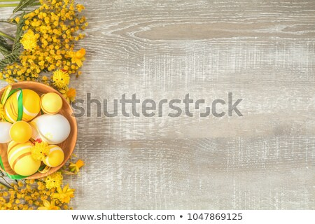 Mimosa and yellow daffodils on a light wooden surface stock photo © artsvitlyna